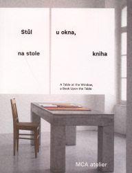 Stůl u okna, na stole kniha =